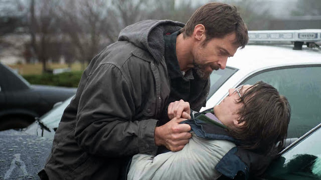 Hugh Jackman grabbing Paul Dano in Prisoners