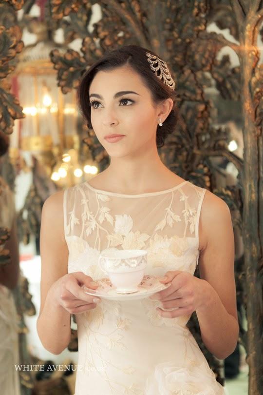 bride holding vintage teacup