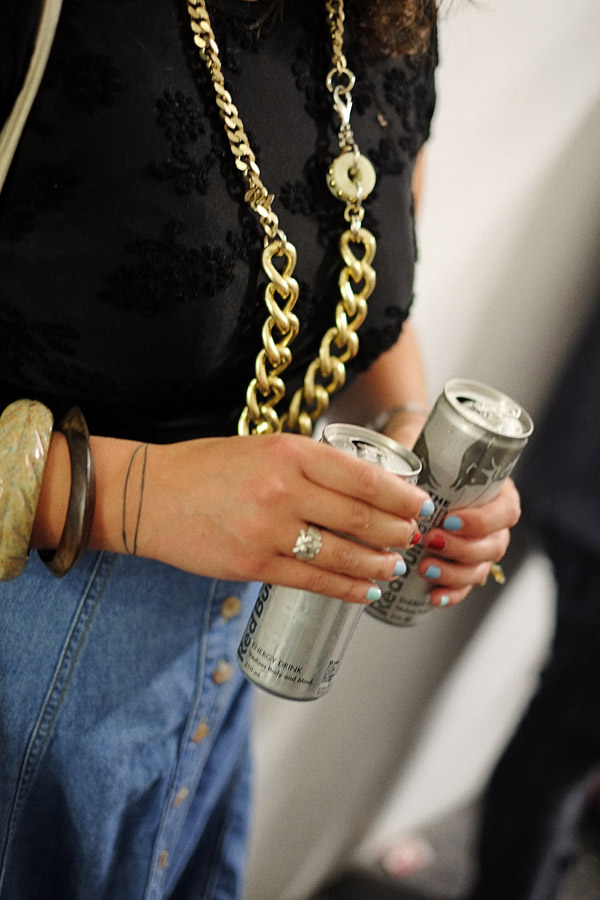Heavy gold chain necklace, Red Bull in both hands, A Study of Hands Friday, October 26 at 6:00pm at China Heights