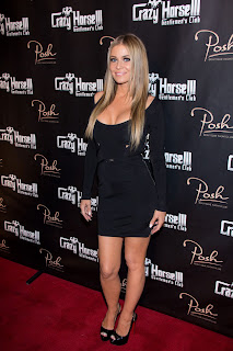 Carmen Electra pozing for cameras on the red carpet at the Crazy Horse III in Las Vegas