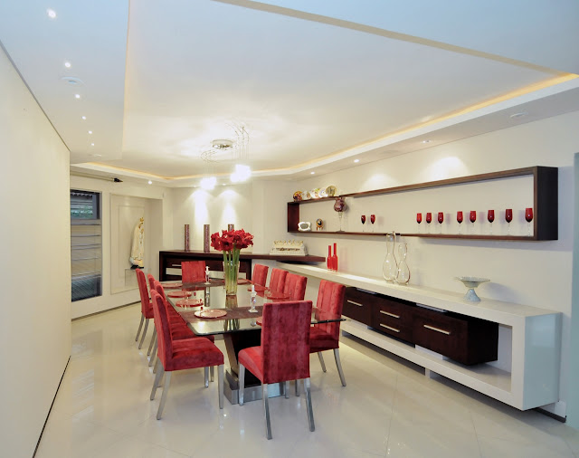 Dining room with red chairs
