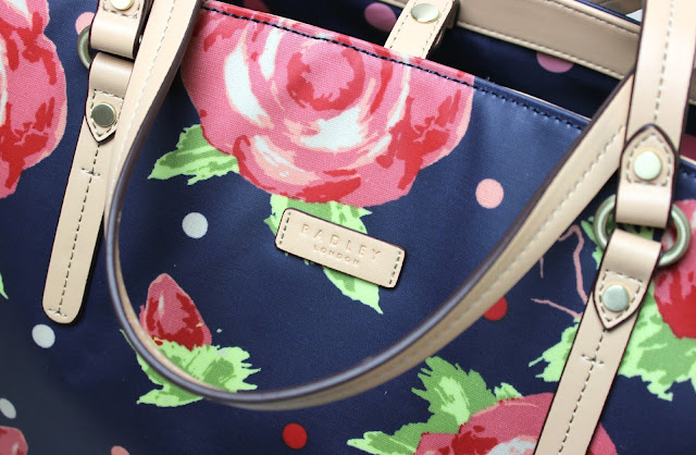 Radley Autumn Rose teaming blooming autumnal roses with deep royal blue