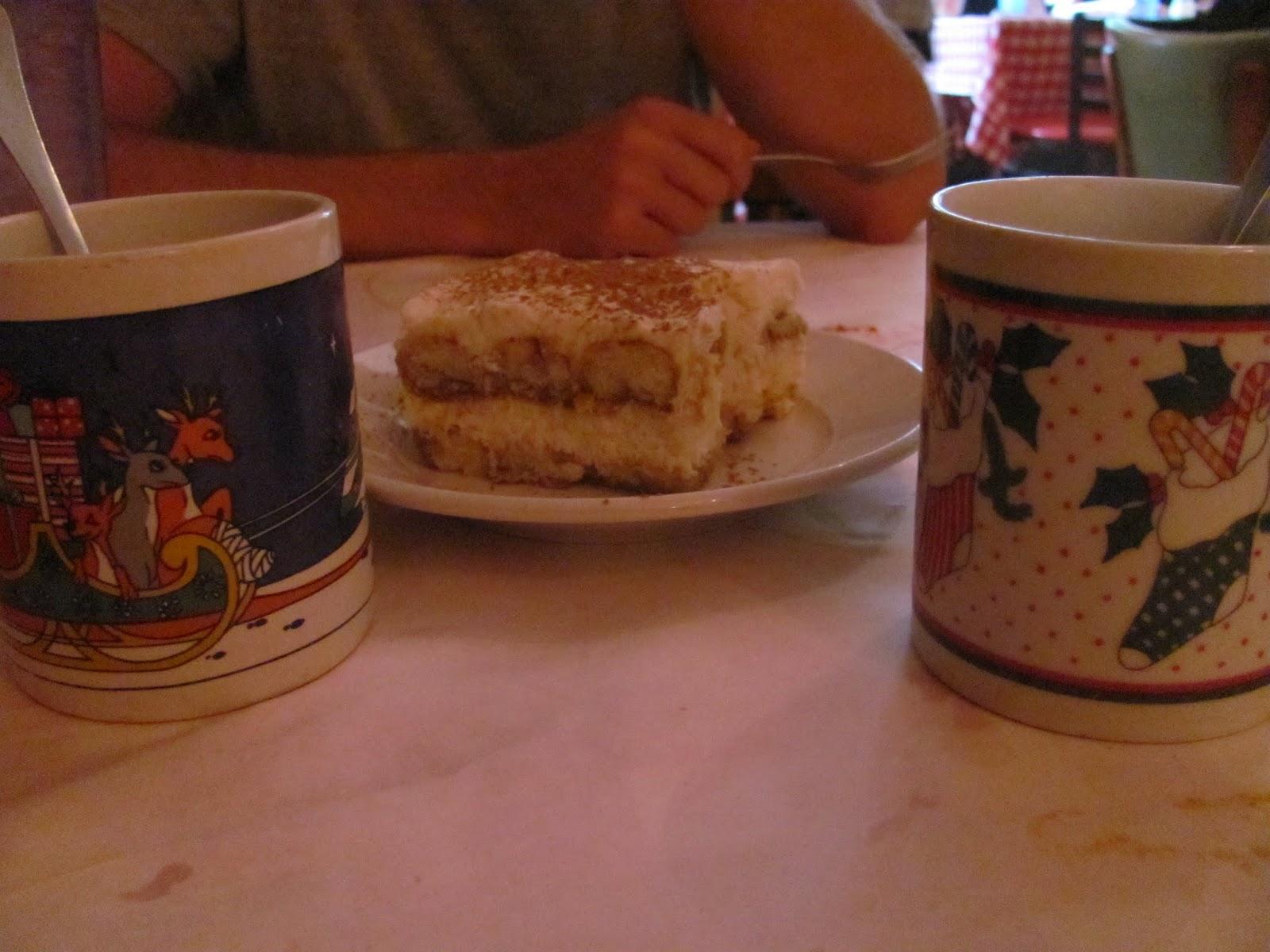 Tiramisu and coffee in Christmas-themed mugs at Mona Lisa's New Orleans, LA