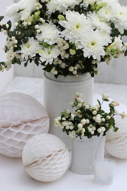 White Chrysanthemums and White Snowberries in white vases