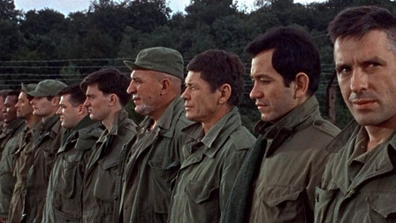 John Cassavetes looking at the camera in the lineup of condemned men from The Dirty Dozen movieloversreviews.filminspector.com
