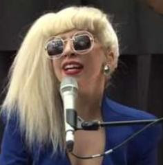 "Lady Gaga gives a live performance of her then, new single ""You and I"" for a special group of fans at Amp Radio"