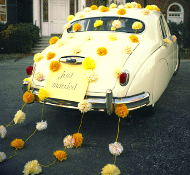 wedding car decorated with pompom garland