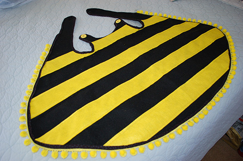 Bumble bee costume icandy handmade to put it on just wrap it around theyre backs and hook the right button to the left button hole and the left button to the right button hole voila solutioingenieria Choice Image