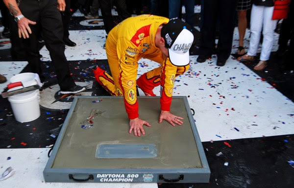 Joey Logano, driver of the #22 Shell Pennzoil Ford, puts his hands into a concrete mold after winning the NASCAR Sprint Cup Series 57th Annual Daytona 500 at Daytona International Speedway on February 22, 2015 in Daytona Beach, Florida. (February 21, 2015 - Source: Jerry Markland/Getty Images North America)