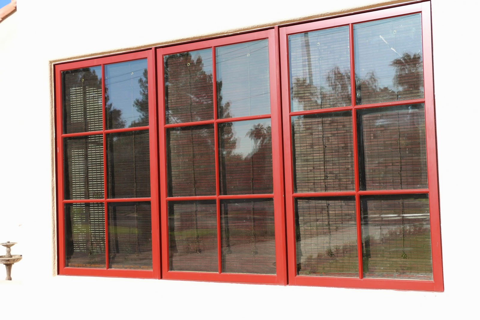 bamboo blinds from the outside, weathershield brick red windows, weathershield casement windows