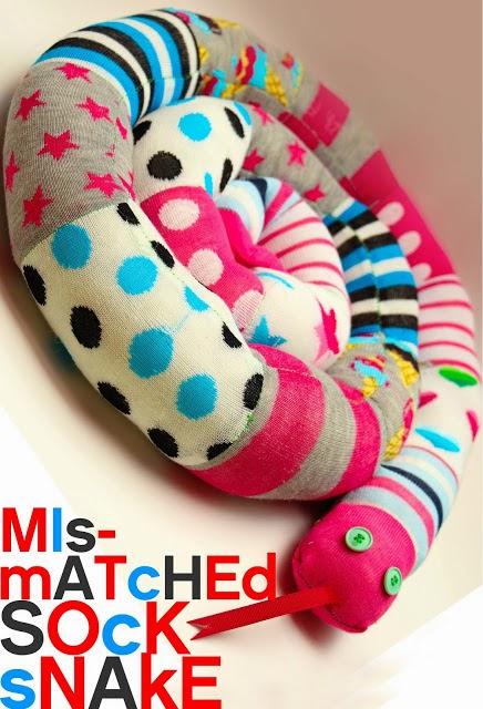 http://grosgrainfabulous.blogspot.com/2013/05/mismatched-socks-sew-sock-snake.html