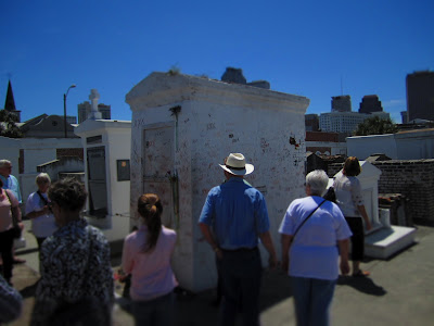 Voodoo Practitioners or Tourists at Marie Laveau Tomb?