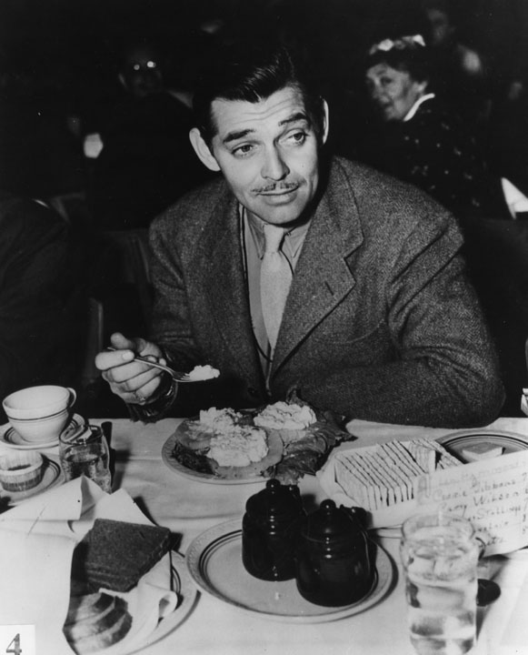 Clark Gable at the table
