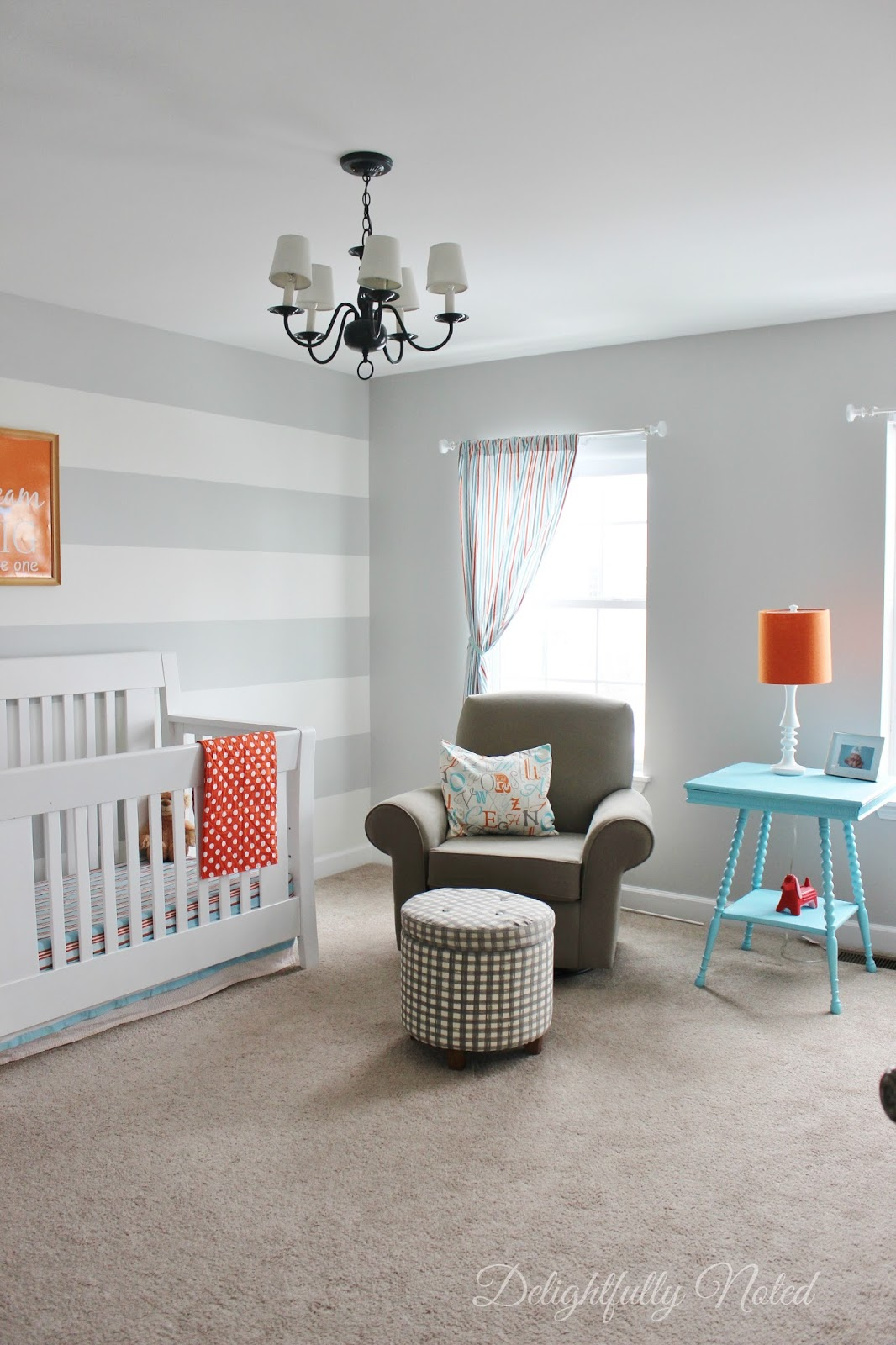 Aqua, Grey, and Orange Nursery with Stripe Wall and Lots of DIY Projects! #nursery #diy