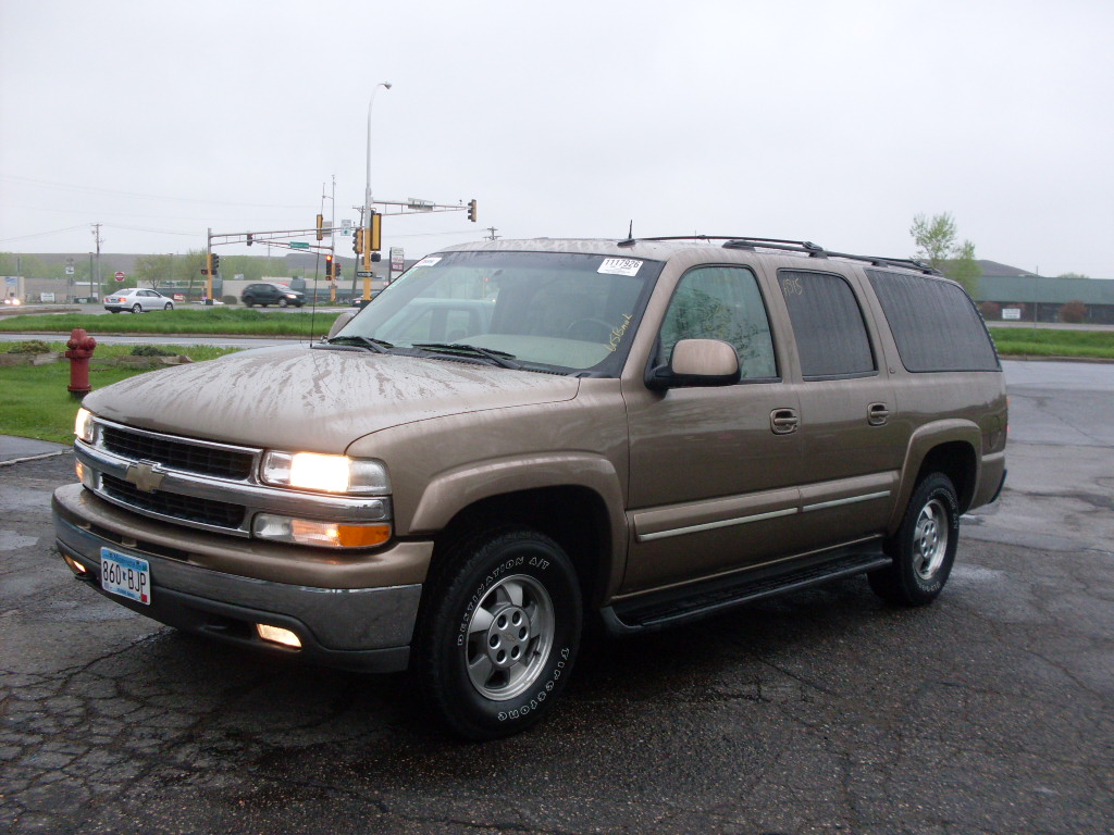Ride Auto 2003 Chevy Suburban Gold