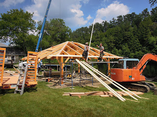 Crew is raising a timber frame for a new pavilion boathous