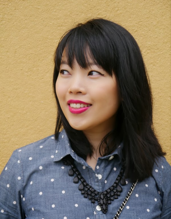 Fuchsia lips, winged liner, tousled bangs, black statement necklace