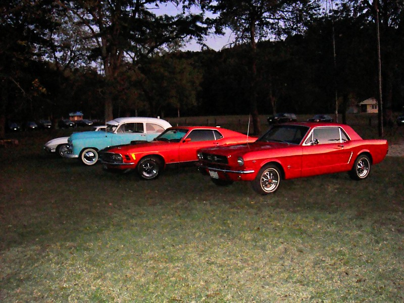 Classic cars parked around the entrance to the party greeted