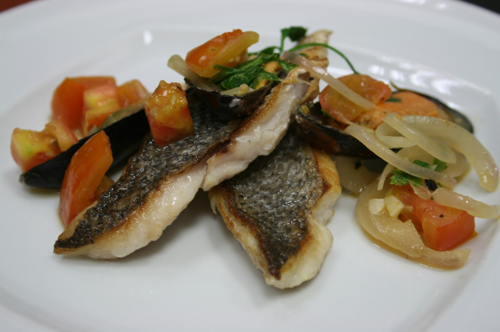 Country gourmet traveler branzino with mussels and tomatoes for Branzino fish recipes