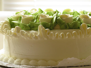 A Cake With White And Green Cake Frosting
