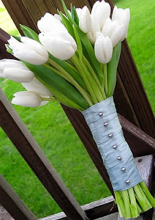 An elegant and simple white tulip wedding bouquet.