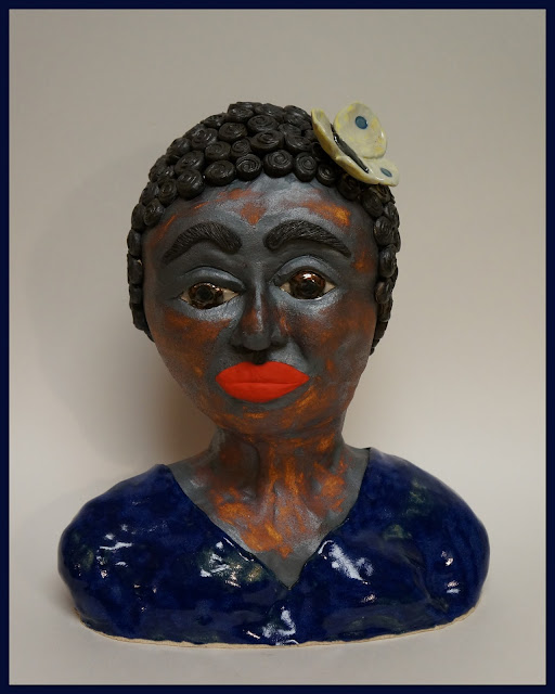 Beautiful negro woman ceramic sculpture by Lily L.