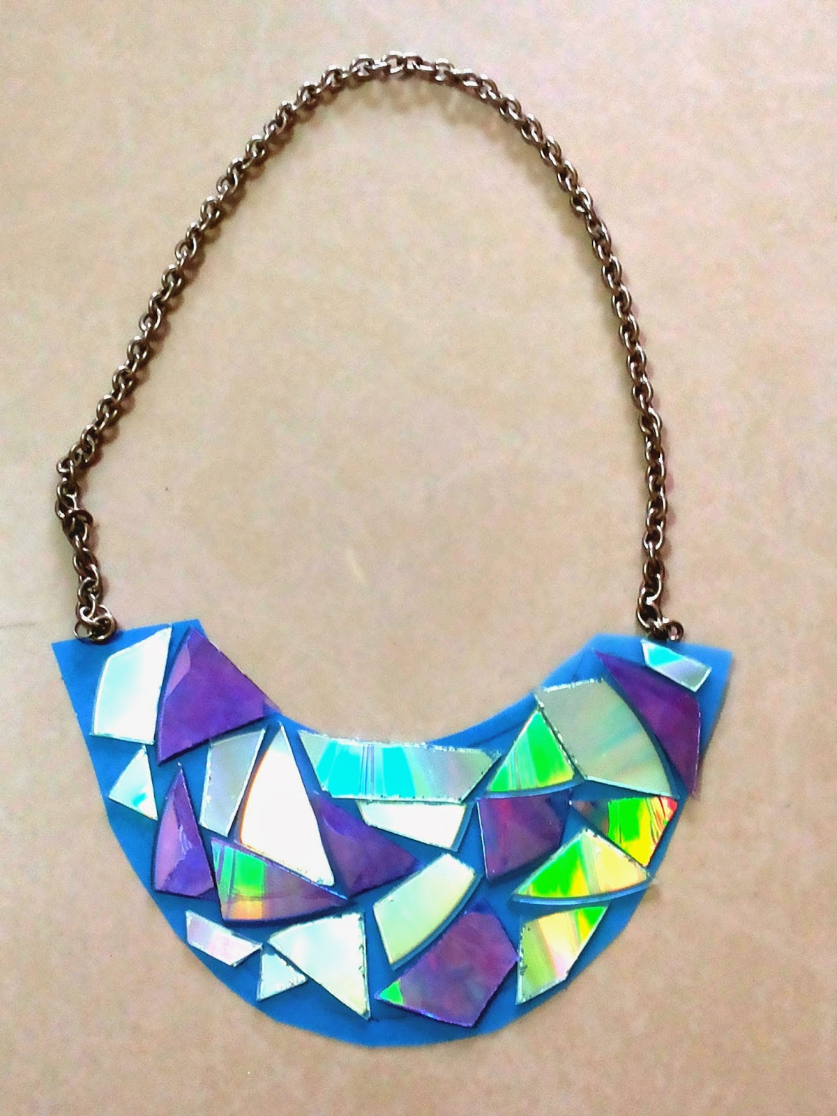 mirror necklace. tip : flaunt this dazzling necklace from day to night and see the reflective mirrors change color. mirror e