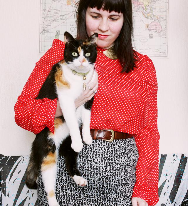 laura redburn holding tortoiseshell cat