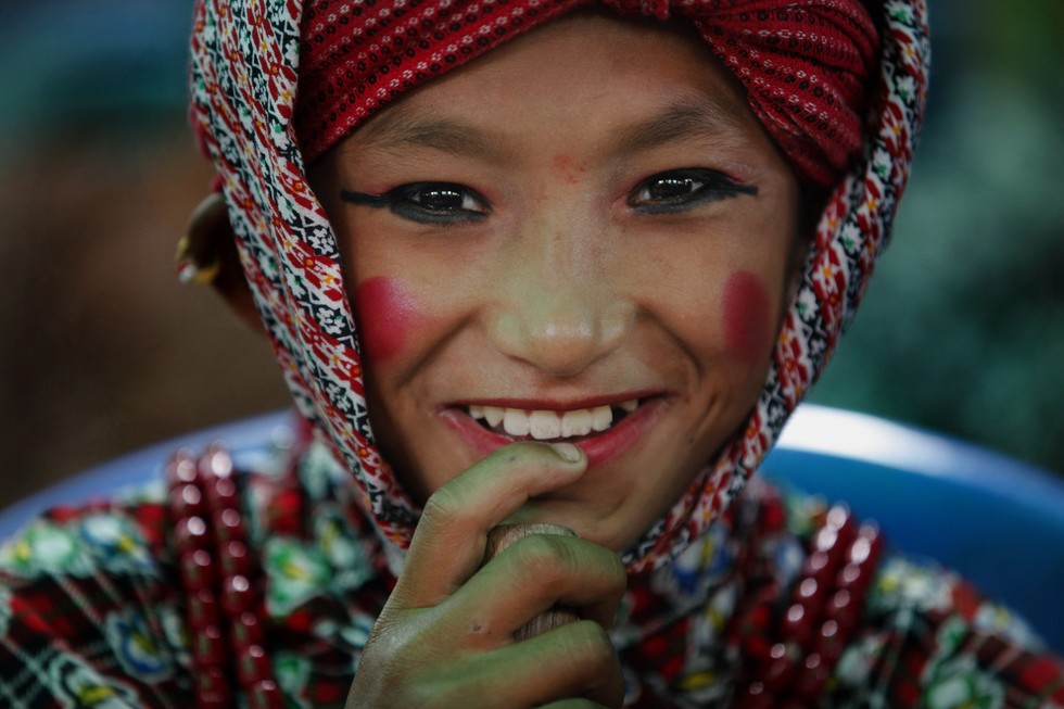 70 Of The Most Touching Photos Taken In 2015 - A Nepalese boy gets ready to perform a dance during a rally held to pay tribute to the victims of the April and May earthquakes, which killed 8,800 people.
