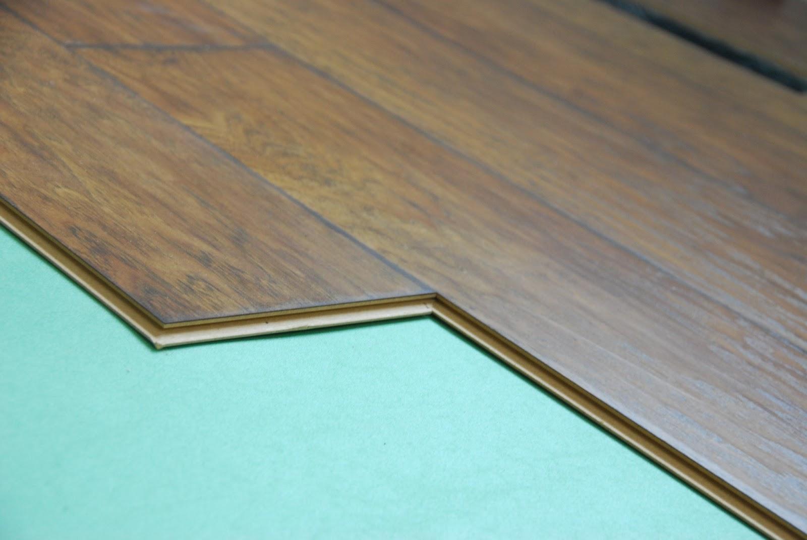 Laminate flooring installing laminate flooring t moulding for Laying laminate flooring