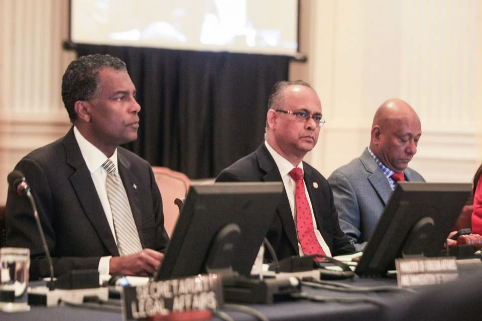 Bahamas Foreign Affairs and Immigration Minister the Hon. Fred Mitchell (left) addressing a Special Permanent Council Meeting of the Organization of American States (OAS) in Washington, D.C., on Tuesday, December 16, 2014. At centre is OAS Assistant Secretary General Albert Ramdin and at right is Ambassador of Guyana Bayney Karran.
