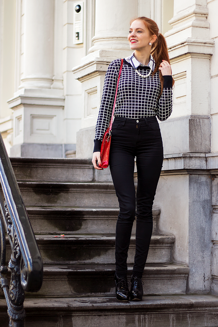 Fashion blogger outfit in preppy style with a print mix of grid, checks and polka dots