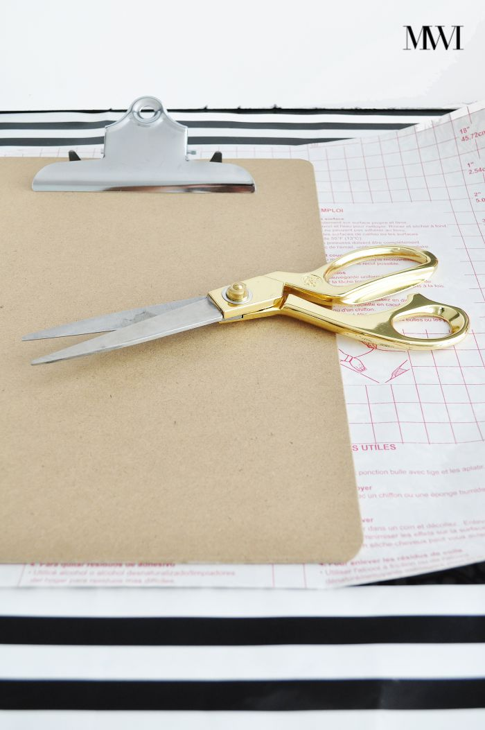 Give a plain chipboard clipboard a chic makeover using contact paper and glitter.