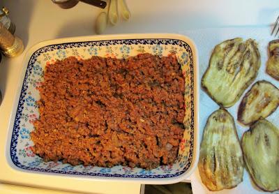 making Greek moussaka