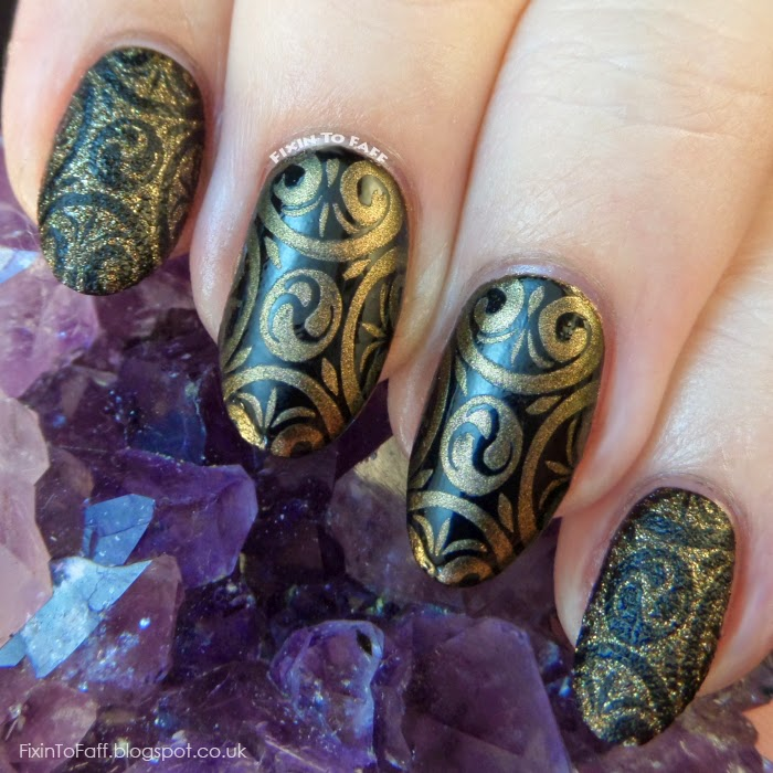 Black gold stamped nail art