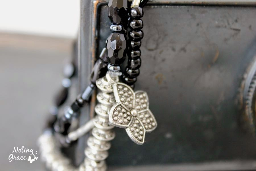 Handmade Jewelry: Black and Silver Beaded bracelet. Three separate strands using stretch cord with a cute little dangle.