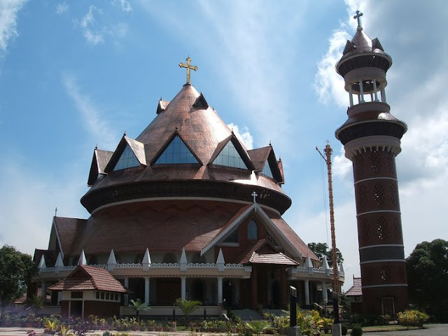 A Cathedral in Thiruvalla, Kerala incorporating the features of a traditional Hindu Temple, a Mosque and Church