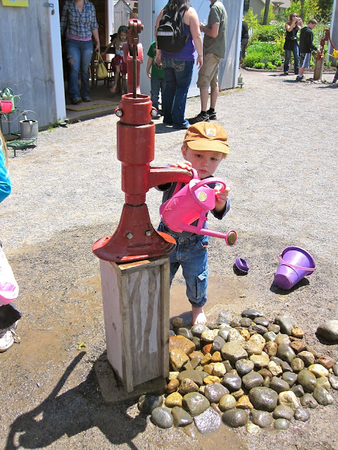 grandson at the water pump