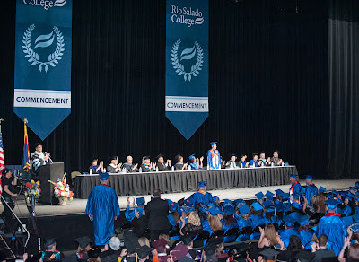 Image of 2014 commencement, students standing to be acknowledged.