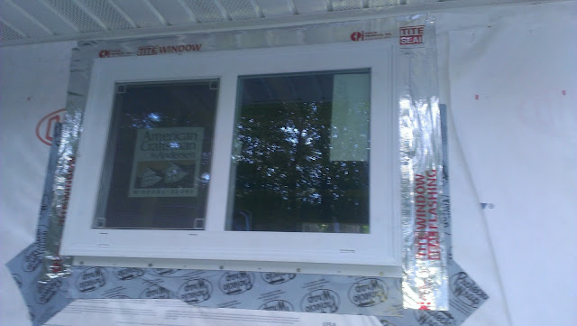 The window nailed in with protective foil around all but the bottom sides.
