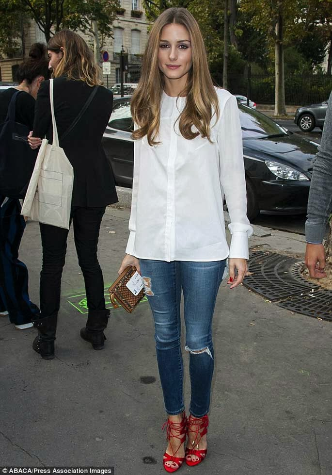 Olivia Palermo at Paris Fashion Week wearing AG Jeans and Aquazzura Heels