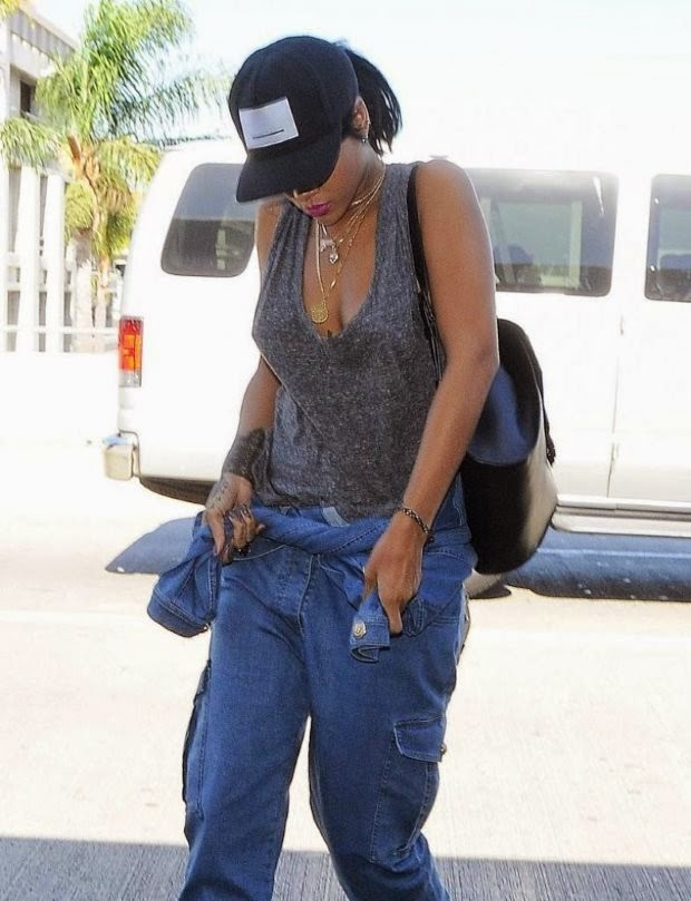 Street Style: RIHANNA Arrives at LAX Airport in Los Angeles
