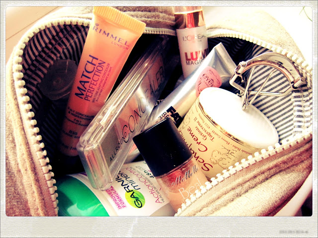 what's in my travel bag rimmel mememe l'oreal eyeko fat brush lumi magique garnier deo eyelash curler