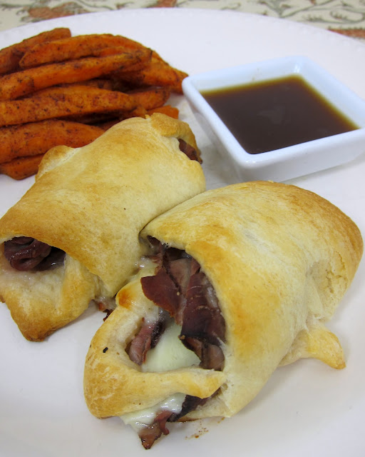 French Dip Crescents - only 5 ingredients. Ready in under 20 minutes!! Roast beef, provolone, horseradish wrapped in crescent rolls - serve with a side of au jus gravy