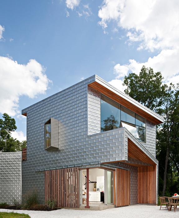 Casa moderna fachada lateral for Casa moderna ma calda