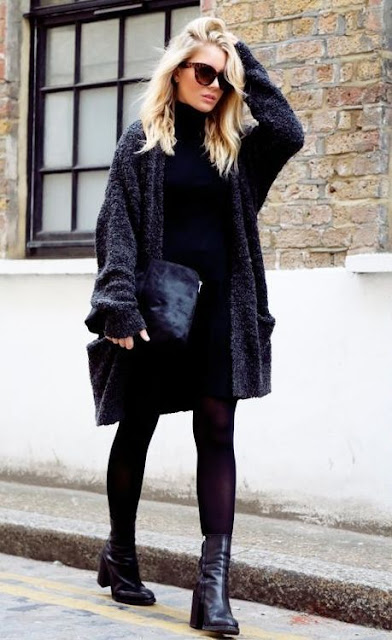 The all black New York girl look. Simple, chick, and effortless. We love her