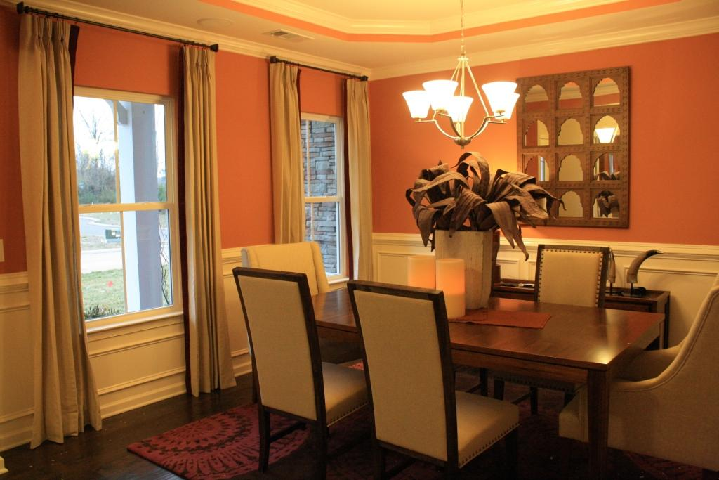 Mirror On The Orange Wall Makes This Dining Room Catchier White Ceiling In Make Nicer Because And Is Good Combination