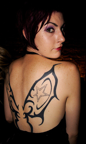 women tribal tattoos. Tribal Tattoo Girl back tattoo
