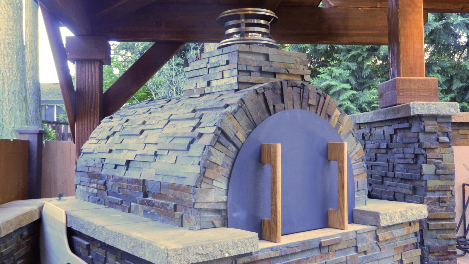 Outdoor Kitchen With Argentinian Grill Brickwood Pizza Oven And Smoker In Kirkland Washington