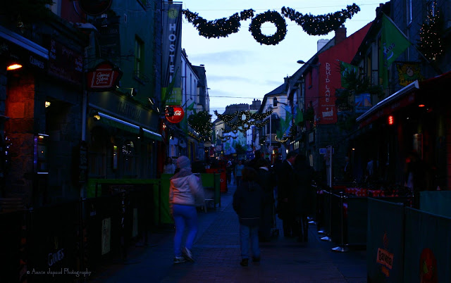 people walking shop street Galway